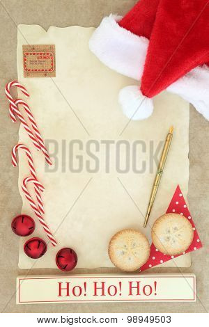 Christmas eve letter to santa with ho ho ho sign, red hat, pen, mince pie cakes and decorations over parchment and brown paper background poster
