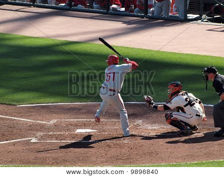 Batter Carlos Ruiz Lifts Leg For Incoming Pitch, Catcher Buster Posey Opens Glove To Catch Incoming