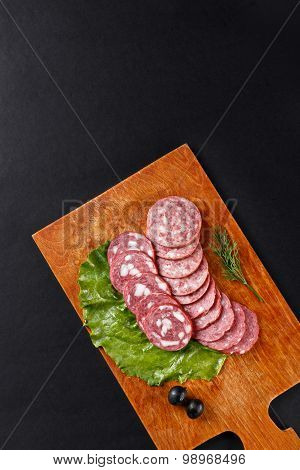 Saveloy Sausage Slices On Cutting Board Topview