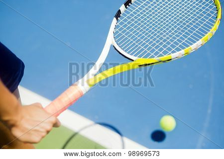 Closeup Of A Player Holding The Racquet Warming Up