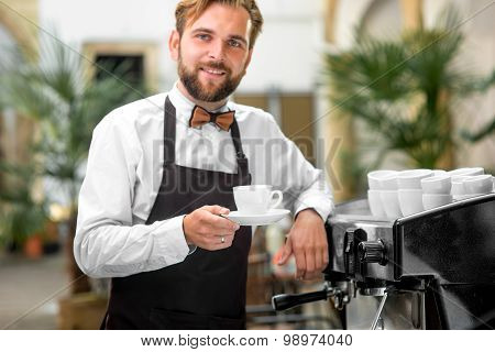 Portrait of barista with coffee cup
