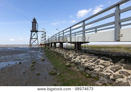 Dorum, Germany - August 9, 2015: Obereversand lighthouse at Dorum in the wadden sea. The lighthouse was erected 1887 in the Weser mound and moved to its current position in 2003.