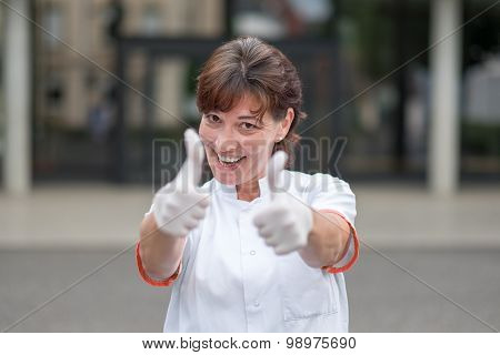 Enthusiastic Doctor Giving A Thumbs Up Gesture