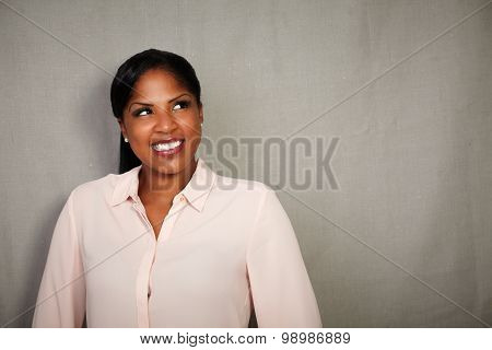 Charismatic woman in formal clothing looking away from the camera while smiling - copy space poster