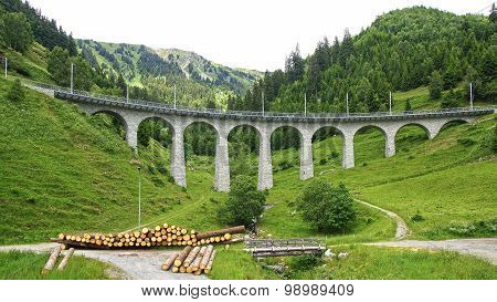 Mountain Train Viaduct In The Swiss Alps.