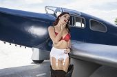 Sexy, pinup dressed in era of the Second World War, beauty redheaded woman poster