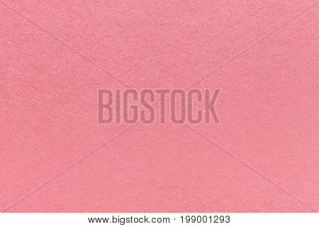 Texture of old light pink paper background closeup. Structure of dense rose kraft cardboard.