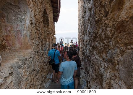 ALANYA TURKEY - JULY 07 2015: Group of tourists in the ruins of the fortress of Alanya.