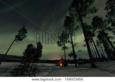 Night Shot Of Northern Lights In Frozen Winter Country