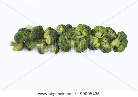 Broccoli at border of image with copy space for text. Broccoli isolated on a white background. Broccoli on white background. Top view.