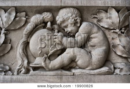 Detail on a sculpted fa?ade in the Grand Palais showing a child sculpting in stone
