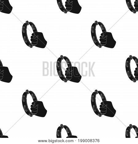 A tambourine that produces a melodic sound. Tambourine in his hand single icon in black style vector symbol stock illustration .