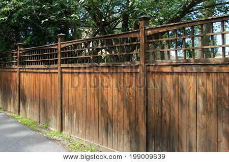 Length of fence, running down side of yard, marking property lines