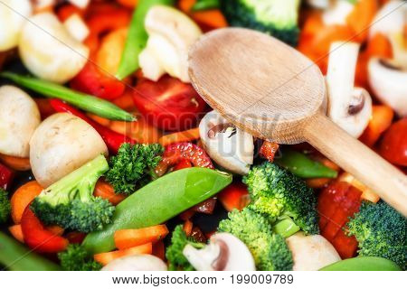 Healthy cooking concept with fresh vegetables and wooden spoon. Food background