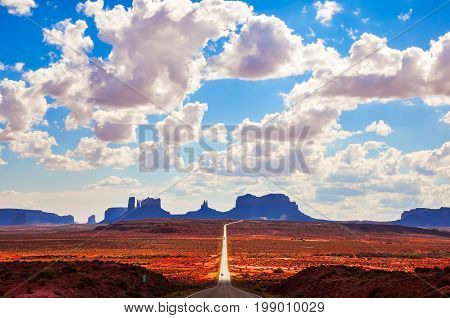 Scenic View Of Road And Monument Valley Landscape