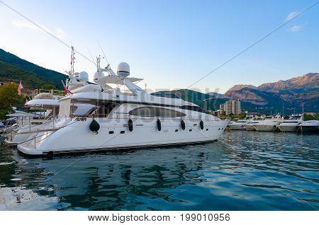 BUDVA MONTENEGRO - SEPTEMBER 15 2015: Pleasure yachts at pier on promenade of Budva resort Montenegro