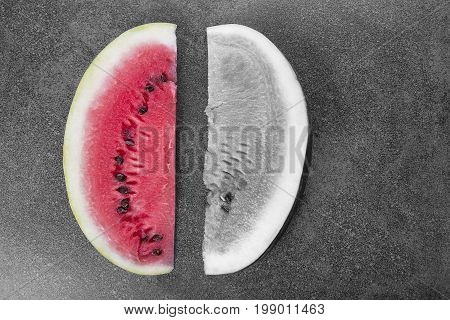 Two sweet watermelon slices on black and white background one slice is colored