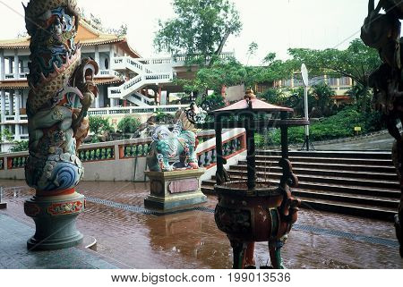 SINGAPORE / CIRCA 1990: Joss sticks burn in an urn at the Kong Meng San Phor Kark See Monastery, also called the Bright Hill Pujue Chan Monastery, Singapore's largest Buddhist temple.
