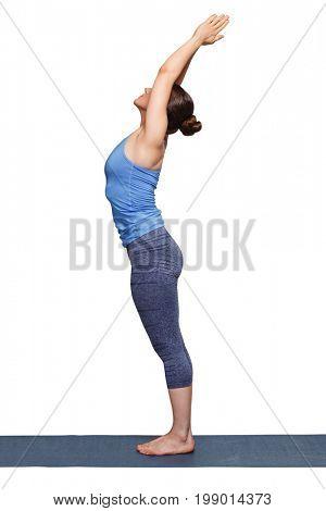 Woman doing Hatha Yoga asana Tadasana - Mountain pose with stretched hands isolated