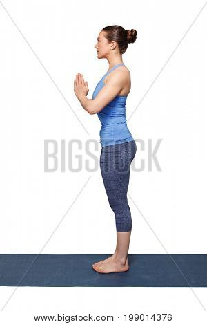 Woman doing Hatha Yoga asana Tadasana namaste -Mountain pose with salutation isolated