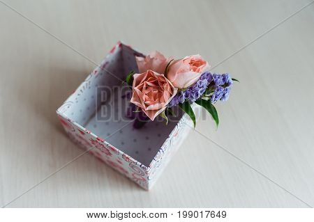 Boutonniere groom with a pink rose, in a box. close-up