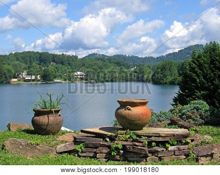 Two clay pots in the foreground of a lake view