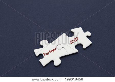 Partnership word written on white puzzle piece.