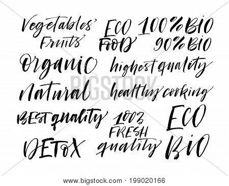 Set of eco phrases. Detox organic 100% fresh quality natural best quality bio eco food vegetables fruits. Ink illustration. Modern brush calligraphy. Isolated on white background.