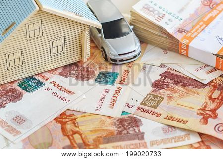 The Concept Of Buying Property And Car: The Layout Of The House, Typewriter And A Stack Of Russian R