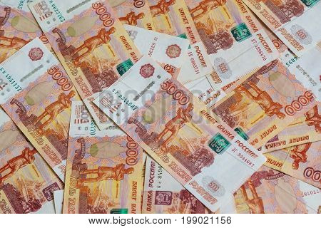 The Concept Of Planning Of Revenues And Expenses: Many Russian Five-thousandth Banknotes Laid Out On