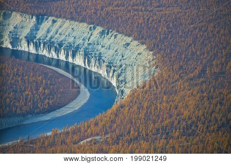 Bank of the river Moierokan and Siberian taiga in the fall from the helicopter. Evenkiya Krasnoyarsk region Russia