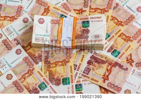 The Pack Of Five Thousandth Ruble Notes In Half A Million Of Russian Roubles Lies On The Background