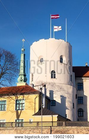 Riga Castle with Latvia and Riga flags. Residence of the President of Latvia