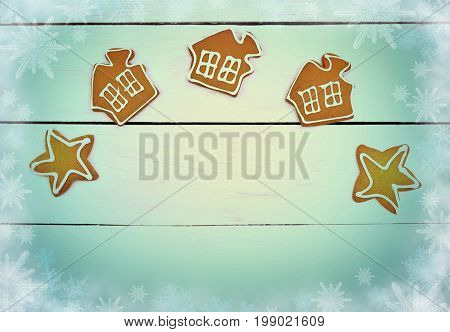Homemade gingerbread with spices and icing on a wooden background. Christmas background in a rustic style. The magic of winter holidays. Homeliness.