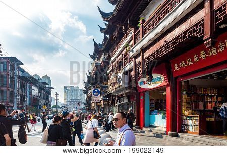 Shanghai, China - Nov 6, 2016: On Fangbang Middle Road - old residential buildings with architectural structures faithfully restored to the traditional Chinese styling and converted into modern-day commercial stores.