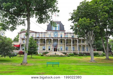 CHAUTAUQUA, NEW YORK - JULY 28, 2017: The historic Athenaeum Hotel, built in 1881, is part of the Chautauqua Institution grounds in New York.