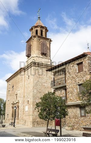 a street and Our Lady of the Assumption parish church in Caminreal, province of Teruel, Spain