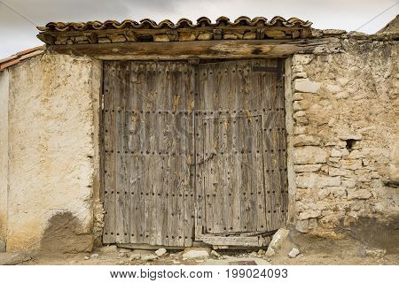 ancient wooden door on a stone made wall