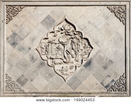 Shanghai, China - Nov 6, 2016: Wall with decorative motif in relief near the 600-year-old Old City God Temple. This wall overlooks Fangbang Middle Road.