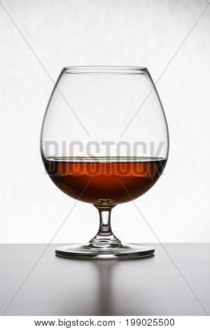 Glass With Cognac On White Background Isolated. Front View. Close Up Shot. High Resolution