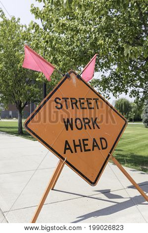 Vertical shot of a sign stating that there is street work ahead
