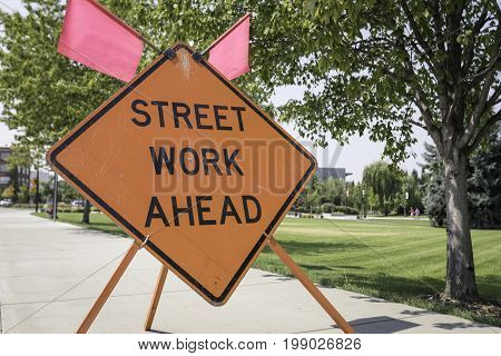 Horizontal shot of a sign stating that there is street work ahead