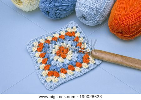 Crochet handmade granny square a hook and yarn balls