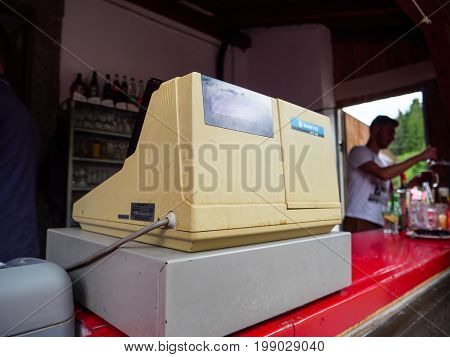 PARIS FRANCE - JUL 16 2017: Dirty old vintage Sanyo checkout counter in operation at outdoor cafe in France