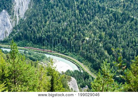 Train track and glacier express seen from top in flims switzerland