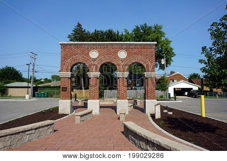 JOLIET, ILLINOIS / UNITED STATES - JULY 17, 2017: Brick arches stand as a memorial to Michael and Mary Czerkics, behind the Cathedral of Saint Raymond Nonnatus.