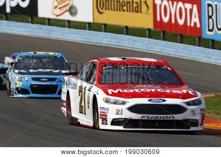 August 06, 2017 - Watkins Glen, New York, USA: Ryan Blaney (21) battles for position during the I LOVE NY 355 at Watkins Glen International in Watkins Glen, New York.