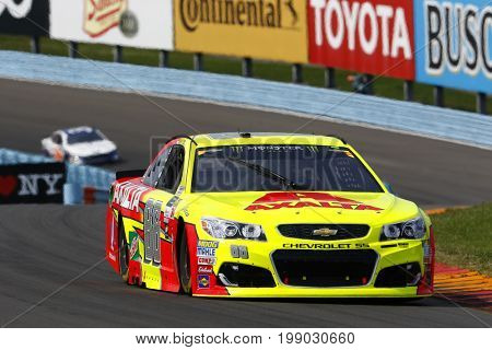 August 06, 2017 - Watkins Glen, New York, USA: Dale Earnhardt Jr. (88) battles for position during the I LOVE NY 355 at Watkins Glen International in Watkins Glen, New York.
