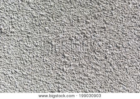 A background of spray of gray cement and concrete on the wall