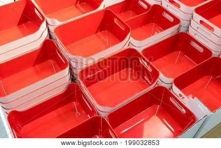 Stack of red plastic trays arrangement for background. Multi-purpose kitchenware collection